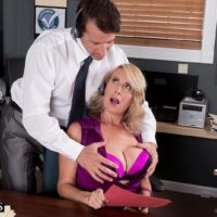 Aged blond woman Laura Layne seducing sex from co-worker in her work environment