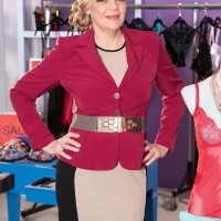 Mature sandy-haired dame Lena Lewis entices her young paramour in tights and garters