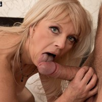 Older light-haired lady munches and fellates on a big dick in her ebony hose