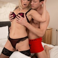 Aged blond dame licks and deep throats on a massive dick in her ebony hosiery