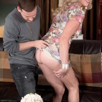 Experienced blond dame Val Kambel has her thong outfitted ass and a tit bared for her