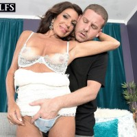 Older dark haired doll Layla LaMora having lingerie and underwear stripped off
