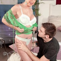 Older lady Honey Ray sports short fair-haired hair while jerking on a youthfull boy's dick