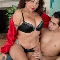 Older doll Sandra Martines entices a junior guy in brassiere and panties combination