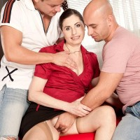 Mature MILF Lorenzia has her cooter and derriere groped by her younger paramours on a sofa