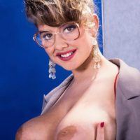 Aged MILF Tracy West sets her giant titties loose in mesh nylons and heels