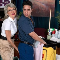 Mature office place worker Cheyanne seduces the janitor in a microskirt and glasses