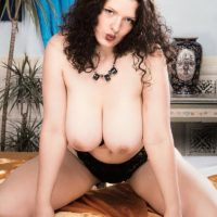 Aged adult film starlet Olga releases her immense knockers before whipping out her thicket in solo action