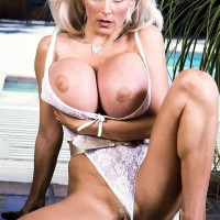 Experienced adult film starlet Platinum Peaks looses humungous juggs from boulder-holder in lace underwear and high-heeled shoes
