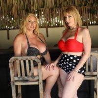 Elderly pornostars Karen Fisher and Sara Jay have lesbian sex while on a glazed patio
