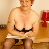 elder redhead girlfriend unleashes large all natural breasts after flashing no panty upskirt