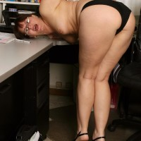 Senior assistant makes her naked strutting debut while at work during solo act