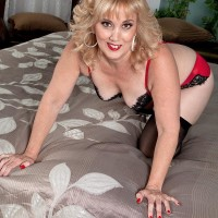Mature mistress with ash-blonde hair Rebecca Williams tempts her spouse in lingerie and hosiery