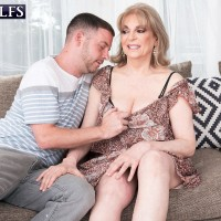 Older doll Crystal King has her enormous funbags toyed with by a younger stud