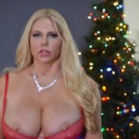 Middle-aged yellow-haired Karen Fisher lets a nip slip loose of lingerie at X-mas time