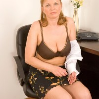 Middle experienced doll taking off skirt and lingerie to model nude at office place desk