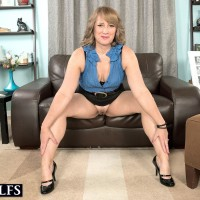 MILF over Fifty Catrina Costa seducing stud in glasses garbed short microskirt and high heels