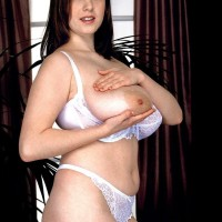 MILF adult film star Nicole Peters baring enormous titties from white brassiere in lace underwear