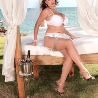 MILF XXX actress Valory Irene models out on an oceanside lawn in her panties