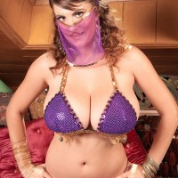 MILF pornographic starlet Valory Irene modeling seductively non naked in harem girl uniform