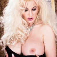All-natural sandy-haired Jay Sumptuous flashes her humungous knockers in a ebony thong and pantyhose