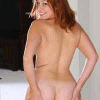 All natural redhead seizes her mind-blowing butt before showing her shaved slit while alone