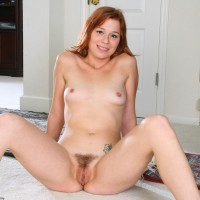 All natural redheaded amateur showing off pointy tits and neatly clean-shaven pussy
