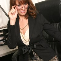 Insatiable elderly chief lady disrobing down to nylons and high heels in her office