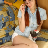 Nerdy red-haired with a great derriere and bush strips off her glasses to model totally nude