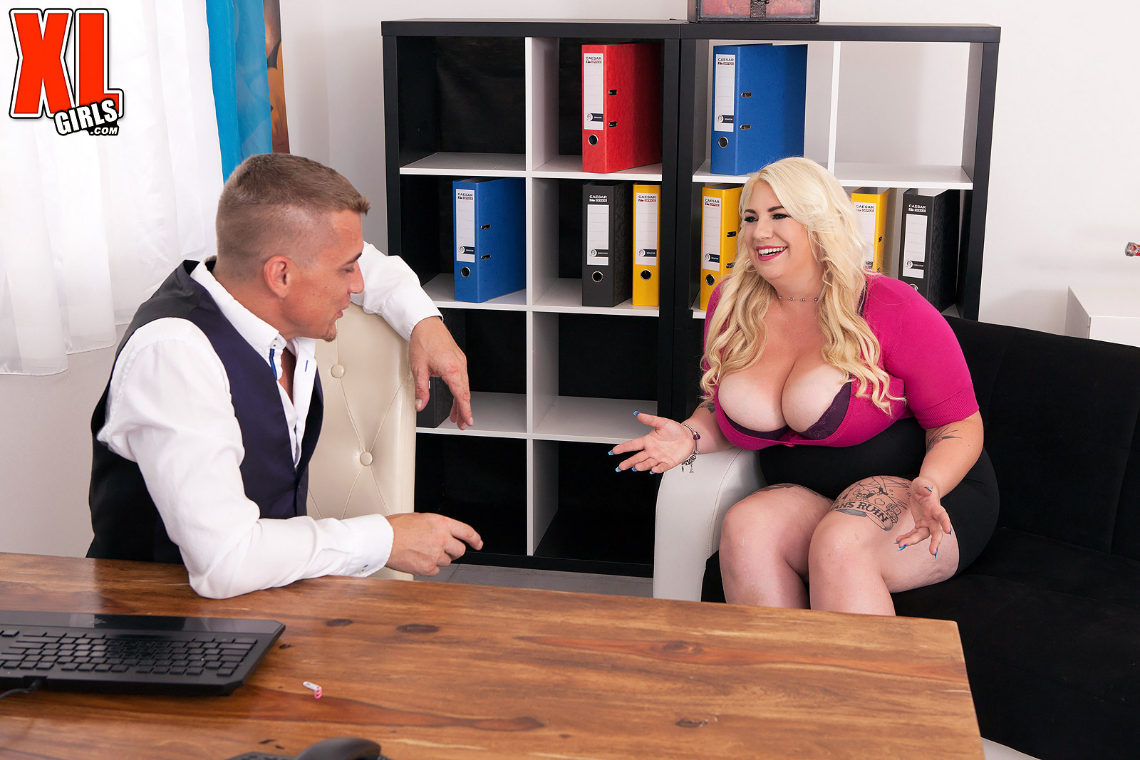 Obese ash-blonde assistant Kiki Rainbow looses her big boobies before tugging on two sausages