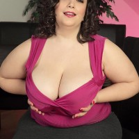 Plus-size dark-haired solo model Mia Bombshell undressing down to her brassiere and undies