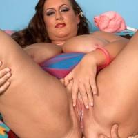 Plus size girl Rose Valentina masturbating while munching cotton candy