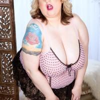 Over weight stunner Porsche Dali teasing the pierced nipples of her huge boobies