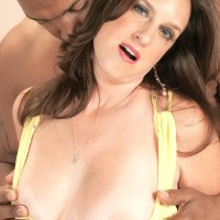 Old gal Gillian Sloan shows her clean-shaven gash on the lap of youthfull ebony man