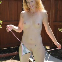 Mature first timer woman peels off swimsuit to pose nude outdoors in back yard