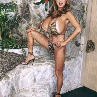 Aged Chinese lady Minka shows her massive breasts before unveiling her clean-shaved snatch