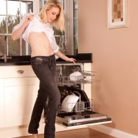 Older sandy-haired gal peeling off denim jeans in kitchen to toy furry fuckbox in barefeet