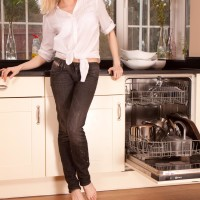 Senior blond broad doffing denim jeans in kitchen to toy furry pussy in barefeet
