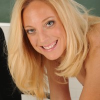 Elder yellow-haired MILF removing biz clothes and lingerie to model naked