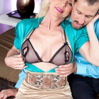 elderly blond doll Cammille Austin tempts her paramour in a cock-squeezing mini-skirt in the bedroom