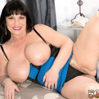 Senior dark-haired broad Elektra letting monster-sized knockers free from dress in high heeled shoes