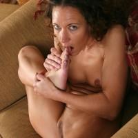 Elder brunette broad with amazing pins slurping her own toes after undressing