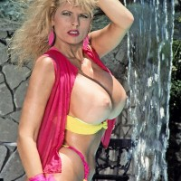Senior adult film starlet Kimberly Kupps pulls out her enormous knockers from bathing suit top by the pool