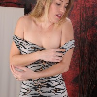 Over 30 yellow-haired crosses her fine legs after peeling off a dress for her first nude poses