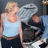 Over 50 sandy-haired Lauren Taylor has her massive boobies and arse revealed by while in a garage