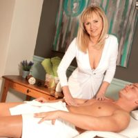 Over fifty golden-haired MILF Arjana seducing junior boy in milky hose and garters