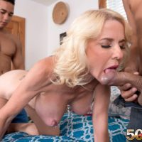 Over fifty yellow-haired MILF Cammille Austin is freed from pink lingerie before MMF sex
