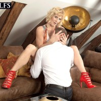 Over Fifty platinum-blonde Molly Maracas uncovers her monster-sized boobs before licking a penis on knees