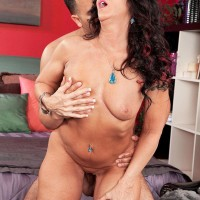 Over 50 brown-haired Azure Dee providing junior stud handjob before doggy fucking