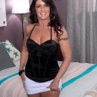 Over 50 dark-haired Azure Dee seducing younger stud in mini miniskirt and high-heeled shoes